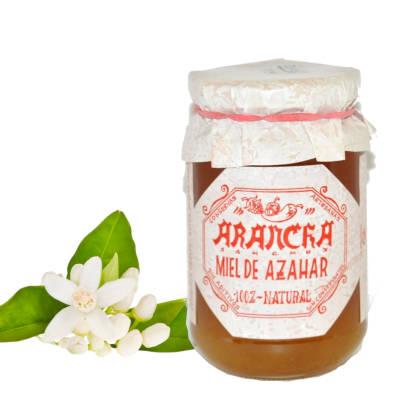 tarro de cristal con miel de azahar 100% natural y hoja y flor de azahar naturales